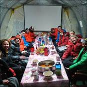 Base Camp team enjoying dinner in the mess tent