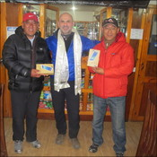 Justin presents tablets to Pemba from Namche Lodge