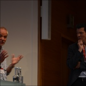 Chris tales questions from the audience whilst Prof Hugh Montgomery looks on